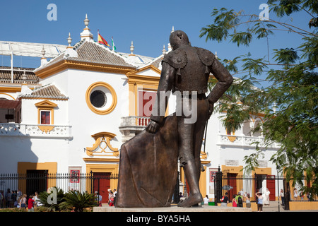 Statue of a bullfighter in front of the Plaza de Toros de la Maestranza bull ring, Seville, Andalusia, Spain, Europe - Stock Photo