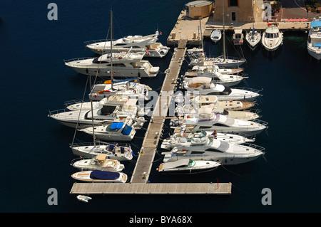 White yachts moored in the Fontvielle marina, Mediterranean Sea, Principality of Monaco, Europe - Stock Photo
