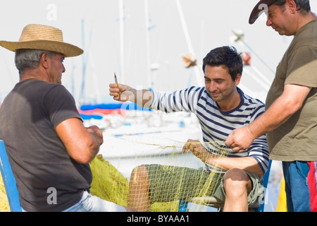 Fisher preparing their net - Stock Photo