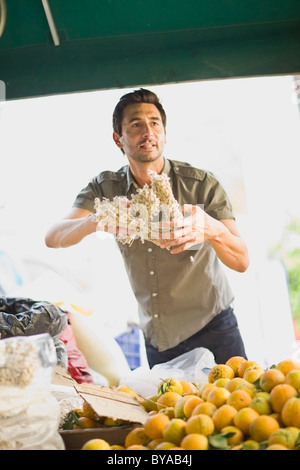 Man selling fruits - Stock Photo
