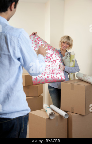 Couple choosing wallpaper samples - Stock Photo