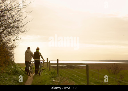 Couple bicycles and sunset, rear view - Stock Photo