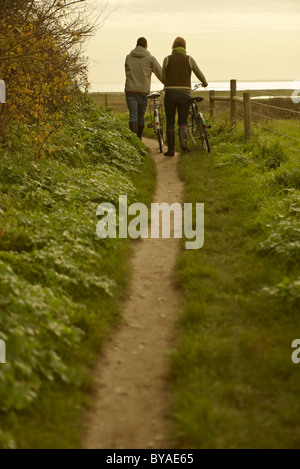 Couple bicycles on path, rear view. Fall - Stock Photo