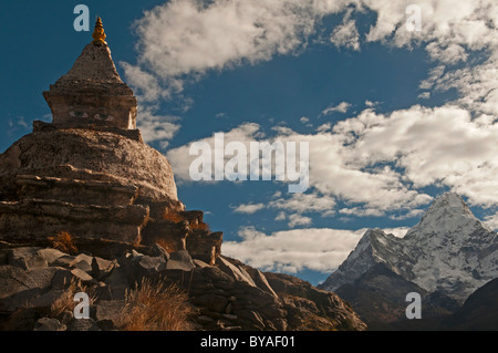 Tibetan chorten and the mighty peak of Ama Dablam in the Everest Region of Nepal - Stock Photo