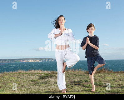 Mother and son practicing yoga - Stock Photo