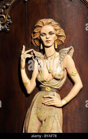 Art Nouveau house emblem of a lascivious woman, wood relief on the facade of the Caffè per Lei Cafe, historic district, - Stock Photo