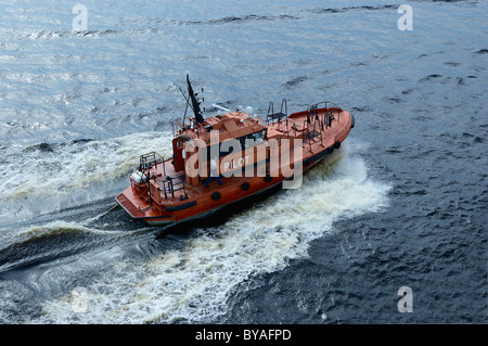 The pilot's boat moves away at speed after guiding a cruise ship out of Helsinki harbour - Stock Photo