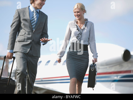 Businessman and Businesswoman on the mov