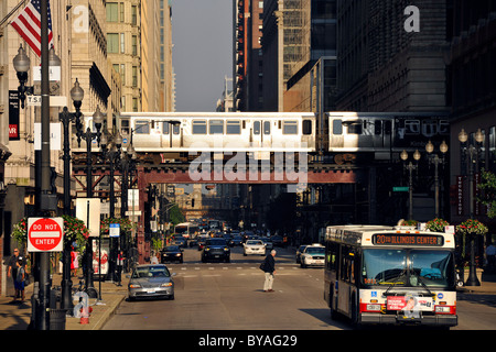 Elevated train lin in Chicago, and El, L, CTA, bus, taxi, Chicago, Illinois, United States of America, USA - Stock Photo