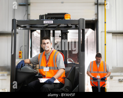 Workers with forklift truck