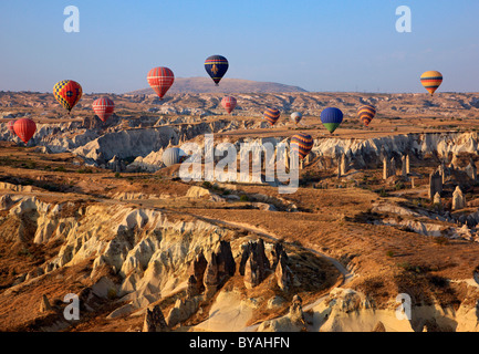 Hot air balloon flight above the spectacular landscape of Cappadocia, Turkey. In this photo, flying over Love Valley. - Stock Photo