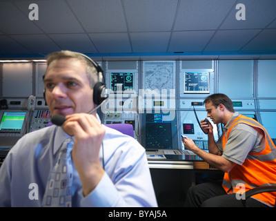 Air traffic controllers in radar room - Stock Photo