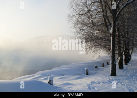Mist rising from the river Oulu in a cold winter day in Oulu, Finland - Stock Photo