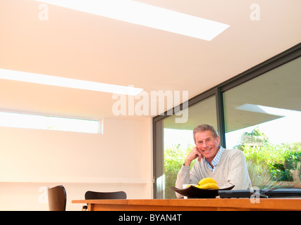 Happy business man at desk - Stock Photo