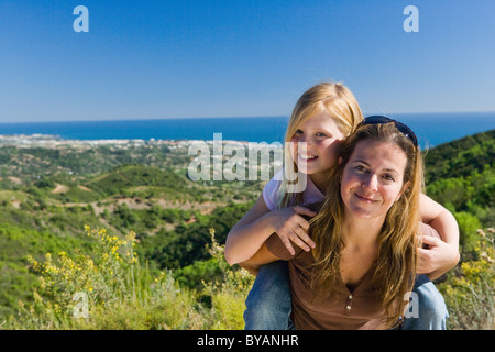 Mother and daughter piggyback ride - Stock Photo