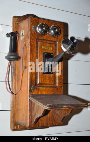 An old telephone with wooden box. Museum of Rockies, Bozeman, Montana, USA. - Stock Photo