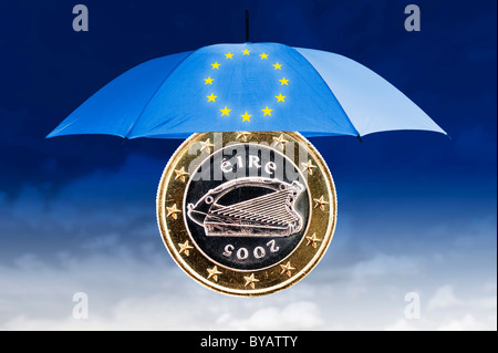 Irish one euro coin under an umbrella with the stars of the European Union, symbolic image EU rescue package - Stock Photo