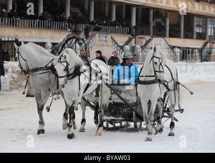 A three-horse-drawn troika in winter, Russia - Stock Photo