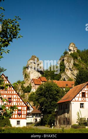 Historic timber mill and a historic half-timbered house built next to Jurassic rocks, Tuechersfeld, Little Switzerland - Stock Photo