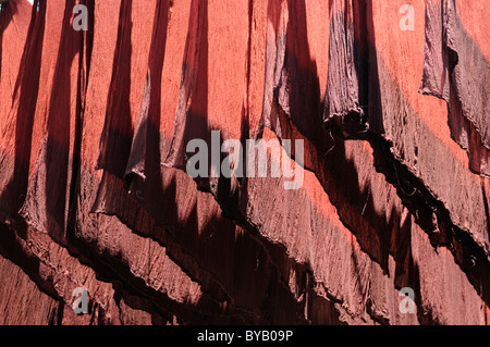 Colorful freshly dyed cloths hung out to dry in the dyers' souq, district of the dyers, bazaar, Marrakech, Morocco, - Stock Photo
