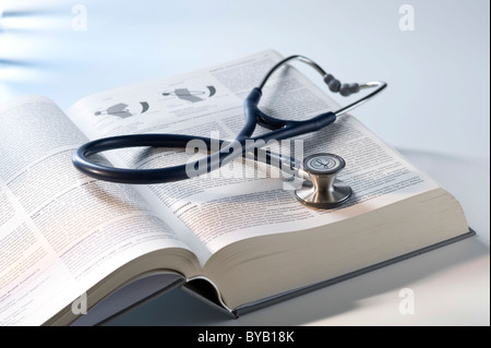 Stethoscope, medicine textbook - Stock Photo