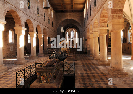 Romanesque nave with the three Hohenzollern tombs and the Gothic aisle, in front the high grave of the electoral - Stock Photo