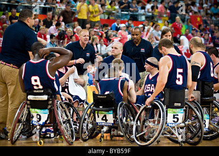 US coach gives his team a pep-talk during a time-out in the semi-final wheelchair basketball match between Canada - Stock Photo