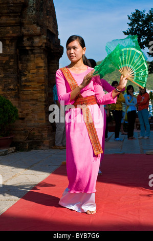 Young woman with fan, Po Nagar, a Cham temple tower, Nha Trang, Vietnam, Asia - Stock Photo