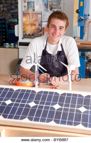 Student learning about wind power and solar panels in vocational school - Stock Photo