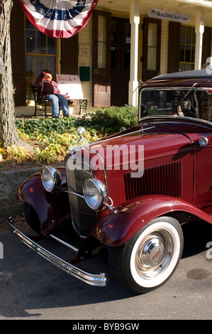 Vintage car parked in front of a typical American home, Connecticut, USA - Stock Photo