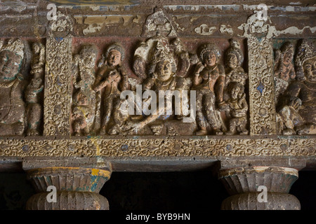 Carvings inside one of the Buddhist Cave in Ajanta in India - Stock Photo