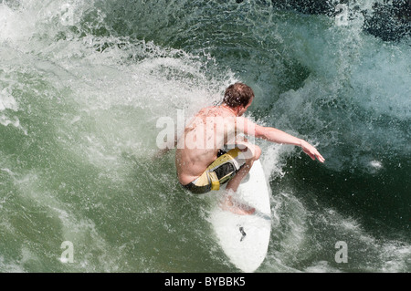 River surfing on the Eisbach in Munich, Germany. - Stock Photo