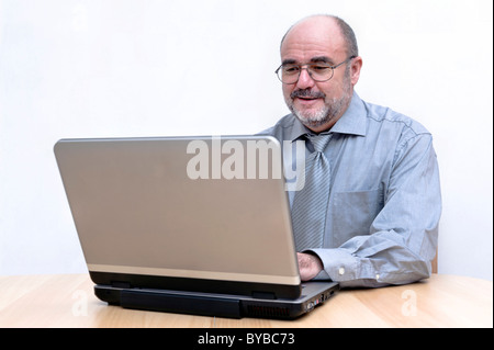 Man focussed on his work on the laptop - Stock Photo