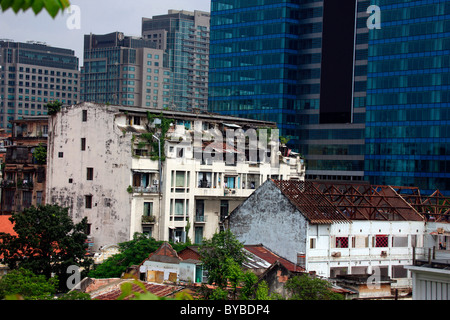 Contrast between old and new, Ho Chi Minh City, Saigon, South Vietnam, Vietnam, Asia - Stock Photo