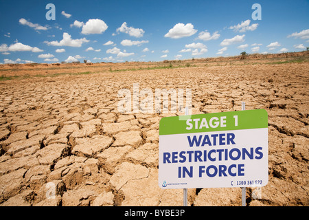 A farmers watering hole on a farm near Shepperton, Victoria, Australia, totally dried up. - Stock Photo