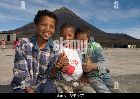 Smiling boys in front of volcano on Fogo, Cabo Verde, Africa - Stock Photo
