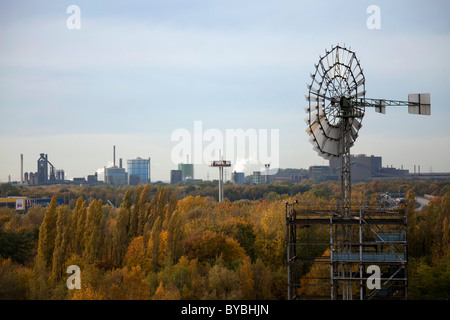 View over a windmill and the Ruhr Area from Duisburg-Nord Landscape Park, Duisburg, Ruhr Area, North Rhine-Westphalia - Stock Photo