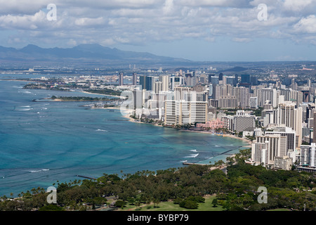 Honolulu and Waikiki Beach. Cityscape of Honolulu with Waikiki and its famous beach in the foreground - Stock Photo