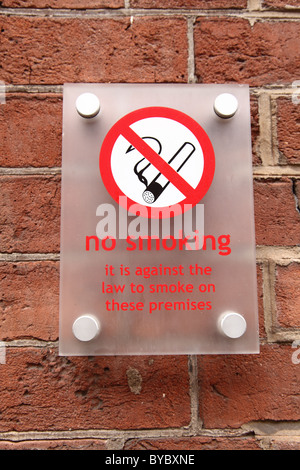 A no smoking sign in a U.K. city. - Stock Photo