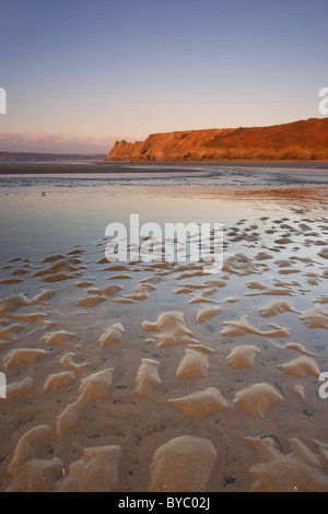View towards Great Tor and Penmaen Burrows from Three Cliffs Bay at Sunrise Penmaen Gower Peninsula South Wales - Stock Photo