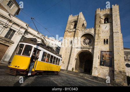 Tram 28 passes by Sé Cathedral, Alfama district, Lisbon, Portugal - Stock Photo