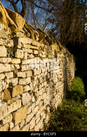 A dry stone wall built with Cotswold stone, Newbold-on-Stour, Warwickshire, England, UK - Stock Photo