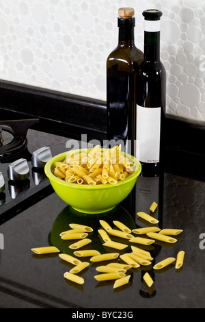 background of modern kitchen and uncooked pasta - Stock Photo