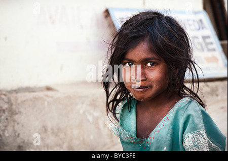 Happy young poor lower caste Indian street girl smiling. Andhra Pradesh, India. Selective focus with copy space - Stock Photo