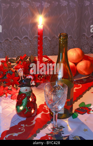 New Year's setting with vine, glass, tangerines, christmas decoration and candle - Stock Photo