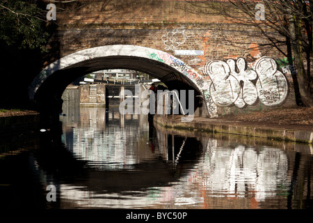 Graffiti on the Mile End Road Bridge crossing The Regent's Canal London - Stock Photo