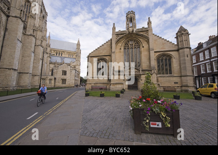 The church of St. Michael le Belfrey, York  and across the road from it, part of the south wall of the Minster. - Stock Photo
