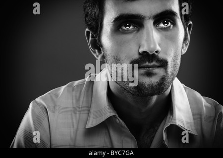 Monochrome toned portrait of a serious young man - Stock Photo