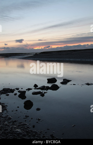 Stones in the foreground sunset - Stock Photo