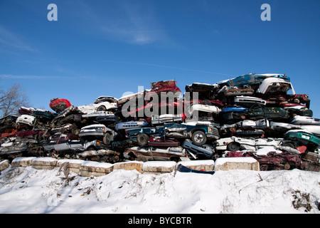 Scrap metal junkyard with crushed automobiles USA - Stock Photo